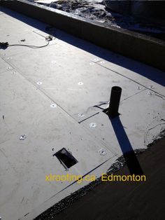 "This spec called for ½"" gypsum board to be mechanically fastened to a steel deck. You can also see in the bottom of the photo a vapour barrier is starting to be mopped down by the Edmonton roofing company, us of course :)"