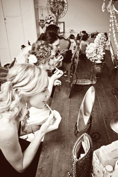 Cute picture of the girls getting ready. Photo by Roee. #weddingphotographersMN #weddingphotography
