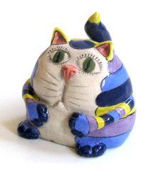 Handmade Ceramic Fat striped CAT/ yellow, blue, lavender. $39.00, via Etsy.