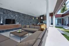 Natural Stone Wall Details Of Mandalay Beach House With Grey Sofa Furniture And Finished With Modern Decoration Ideas For Inspiration