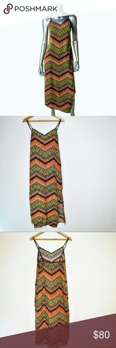 SANCTUARY Slit-Sides Island Love Tank Dress A vibrant tropical chevron clean-angle cut side slits flirty detail crafted with 100% Polyester. Silhouette- Shift. Sleeve Length- Adjustable Straps. Closure- Hidden Side Zipper. Dress Length- Ankle-Maxi. New condition. Sanctuary Dresses Maxi