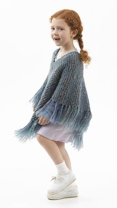 Downtown Poncho - crocheted version. There's also a pattern for a knitted version. Yarn has been discontinued.