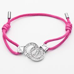 Swan Boutique ❥ Handcuff Bracelet Medium CZ ❥ Cuffs of Love bracelets symbolizing Locked by LOVE. Available in heart shape or round cuff design, with optional sparkling cubic zirconia accent, and a variety of vibrant colored cords.