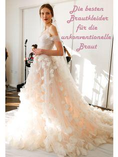 Unkonventionelle Brautkleider! Ein Traum-Hochzeitskleid von Marchesa mit aufgenähten Blüten und auslandender Schleppe.Nicht unkonventionell genug? Dann klickt weiter!