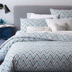 A colorful update to our standard chevron, the Pop Zigzag Duvet + Shams features a stripe of fun color within the pattern. Match your sheets to the accent color or let it pop against neutral layers.