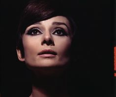 21 Impossibly Charming (and Rare) Photos of  Audrey Hepburn | Even in heavy '60s makeup, Audrey is sublime!