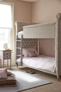 Jack&Tara's Crown bunk beds will make your little princesses feel they're part of a fairy tale every single night.  Perfect for whispering secret at sleepovers, extra storage, or for giving growing sisters their own little bit of a space, these bunk beds have been upholstered in the softest velvet. Deep buttoning and a traditional silhouette adding a little touch of heritage.  Available in different sizes and fabrics, upholstery in own fabrics also available. Full range of Jack&Tara…