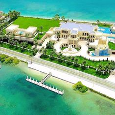 """$$$ This $159,000,000 mega mansion (the most expensive listing in the USA) is located at 935 Hillsboro Mile in Hillsboro Beach, Florida, and is called """"Le Palais Royal"""". The 60,500 square foot home sits on 4.5 acres of waterfront property and features a 30-car underground garage, 11 bedrooms, 17 bathrooms, an IMAX Theatre, a massive remote controlled LED-lit infinity pool, gym, spa, night club, ice rink, ball room, indoor pool, and a $2,000,000 22-karat gold plated double staircase $$$"""