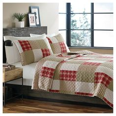 The Camano Island mini quilt set by Eddie Bauer features an updated irregular printed patchwork design in reds and khakis. The classic stripe reverse and the diamond quilt stitch add depth and dimension to the design. The Camano Island mini quilt set by Eddie Bauer will set the tone for your cozy, casual bedroom.