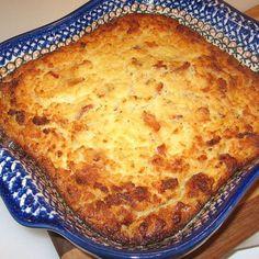 This Polish potato pie recipe - baba kartoflana or kartoflak - is similar to Lithuanian kugelis and uses grated potatoes, bacon and eggs.