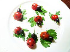 cherry tomato ladybugs on white plates