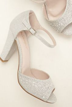 """Step into this Vintage-inspired peep toe sandal and create your timeless look for an elegant evening! Peep toe chunky heel sandal features sparkling glitter and stone detail. Adjustable ankle strap ensures a secure fit. Heel measures 3 3/4"""". Manmade cushioned sole. Imported by Coloriffics."""