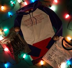 Shop the latest OFFICIAL Stranger Things merchandise including Stranger Things t-shirts, Funko figures & more! Embark on an investigative adventure and step into Hawkins, Indiana and experience Stranger Things. Stranger Things Merchandise, Stranger Things Hoodie, Stranger Things Halloween, Stranger Things Netflix, Hot Topic Stranger Things, Cute Outfits, Tv, Image, Unicorn Horns