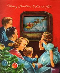 1950s Christmas card featuring a family watching television.