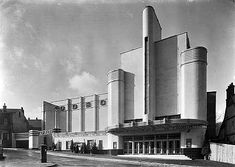 The Woolwich Odeon opened on 25 October Designed by George Coles, it displays the 'Odeon style' of buff faience tiles and curving horizontals and verticals. The wall bearing the name Odeon hides an integral car park. Cinema Architecture, Bauhaus Architecture, Drawing Architecture, Amsterdam, Balustrades, Fine Art Prints, Framed Prints, Streamline Moderne, Art Deco Buildings
