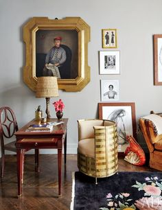 A late-19th-century family portrait gazes down on a Louis XVI desk and an early Thonet wood chair in the television room; the other artwork includes a Robert Doisneau photograph of Pablo Picasso and a Juergen Teller image of model Kristen McMenamy | archdigest.com