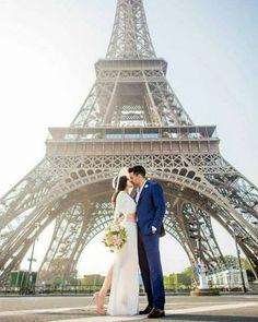 Couple near Eifel tower in Paris.