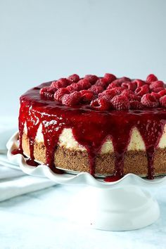 This souffle cheesecake is light as air with a cheesy, creamy, lemon soufflé filling topped with a divine raspberry sauce that's sweet and slightly tart.