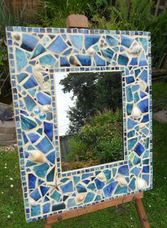 'Sea Shore' mosaic mirror, made using broken pieces of hand glazed pottery, shells and glass pebbles.