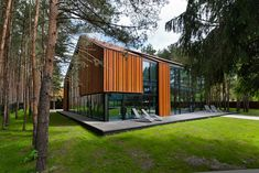 "This home located in the middle of the woods in Kaunas, Lithuania was constructed in 2011 by Studija Archispektras. The outside of the structure is a pleasant mixture of wood and glass, the latter of which reflects the woods which surround the home. The inside is spacious, bright, and stylishly modern. A House in the Woods of Kaunas by Studija Archispektras: ""The house is situated on the river shore. The.."