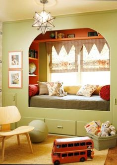 Nooks and window seats provide special areas for kids to cuddle up in so we love this design and even though lime green and red aren't everyone's first choice of color for a child's room but its a more contemporary alternative than blue or pink.