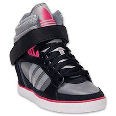 """From celebrities, fashionistas and the girls-next-door, the sneaker wedge has become the """"It"""" shoe and is a trend that shows no signs of slowing down.  adidas has taken this style and designed the Women's adidas Amberlight Wedge Casual Shoes, kicks so"""
