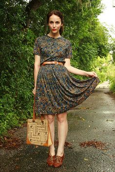 Blue paisley dress with tan belt. Dress is cute, but has too hight of a neck for those who are brestfeeing (if you know what I mean).