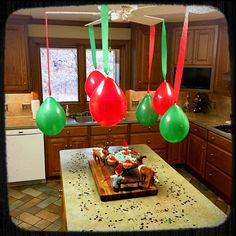 Dasher had a surprise birthday party at the North Pole, so Scout & Peabody brought some of the party home to us! #elfontheshelf #dasher #birthdaycupcakes #confetti #balloonsandstreamers #happybirthdaydasher