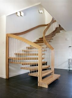 Timber stair design with oak treads and stainless steel spindles