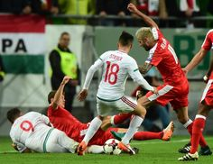 Hungary's Adam Szalai and Zoltan Stieber figth for the ball with Switzerland's Captain Stephan Lichtsteiner and Valon Behrami (R) during a WC 2018 football qualification match Hungary v Switzerland in Budapest on October / AFP / ATTILA KISBENEDEK October 7, Garra, Fifa World Cup, Hungary, Budapest, Switzerland, Football, Sports, Attila