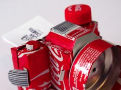 A working camera made from 6 cans of coca cola - by Joe Mortell
