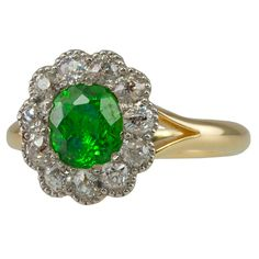 Antique Demantoid Garnet and Diamond Ring, Rare 1ct demantiod garnet center with that signature, lime green color, surrounded by old european cut diamonds in a flower design.  Platinum and 14k. Late 19th century.