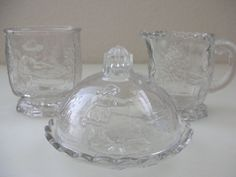 Grandma M.s childhood dishes  EAPG 1880s Nursery Rhyme Victorian Toy Glass Set of 4 pc Footed Creamer Open Sugar Covered Butter Dish from The Back part of the Basement. $150.00, via Etsy.