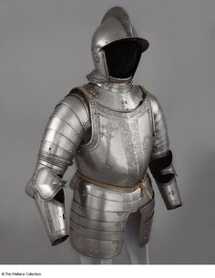 Partial armor; Michel Witz the younger (1539 - 1588), Armorer; Innsbruck, Germany 1555. Steel, copper alloy and leather, blackened, embossed, and etched Weights: 1.53 kg, burgonet 2.43 kg, gorget and spaudlers; 4.47 kg, breastplate and tassets; 2.15 kg, backplate Weight: 1.22 kg, vambrace (right) Weight: 1.14 kg, vambrace (left) Weight: 0.28 kg, besagew (right) Weight: 0.31 kg, besagew (left) Inscription: 'W.E. G.I. D.R.G.S. H.D.G.G. 1555' Inscription: '1555' Etched A37 European Armoury III