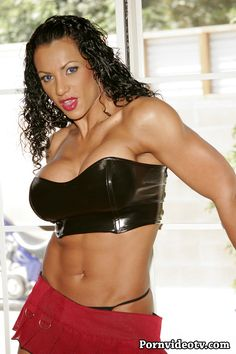 Tall and strong Fitness Goddess powerful dominant muscles in latex and high heels