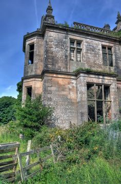 Poltalloch House, Lochgilphead, Argyll and Bute, Scotland. A large Victorian mansion built in ashlar with curvilinear gables. Formerly the seat of Malcolms of Poltalloch. Built to replace Kilmartin House. Known as Callton Mor in later 19th century. Roof removed in 1957 to avoid paying tax.
