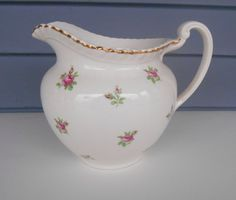 Vintage Creamer Jug Pitcher - Old English Johnson Bros - Chintz Pattern with Pink Flowers and Gold Trim by TollethHouseVintage on Etsy https://www.etsy.com/listing/179528201/vintage-creamer-jug-pitcher-old-english
