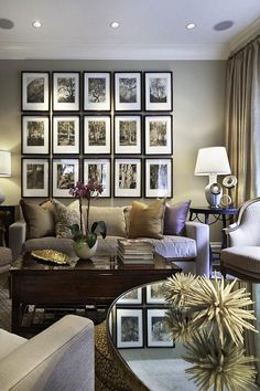 Neutral living room with great picture wall.