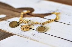 How to Make a Coin Charm jewelry. stamped with years she visited there or initials on coins from certain dates like wedding, etc.  via lilblueboo.com