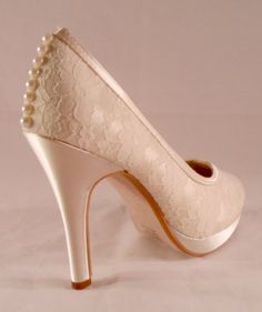 These lace platform heels are dyed ivory. They also have faux pearls up the back seams of the heels. They have a 3 3/4 heel. These may be dyed any