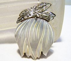 Vintage crystal rhinestone dress clip brooch Mother of pearl shell flower, with rhinestone leaves Silver tone setting Unsigned 1 7/8 x 1 1/2 inches Good vintage condition, ... #gotvintage