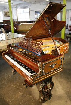 An 1897 , Bechstein grand piano with a rosewood case in Louis XV, rococo style. Ornate, brass Ormulu Mounts cover the entire case. The pierced, legs mimic the shape of the piano lyre. This Bechstein piano formerly belonge resided at Swinton Park, North Yorkshire and belonged to William Whitelaw, Home Secretary under Margaret Thatcher.  #bechstein #bechsteinpiano #artcasebechstein