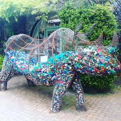 We found these two sculptures at Betws-y-coed yesterday. The rhino has two holes in the top so you can 'feed him' plastic bottle tops. The orangutan (?) was made entirely out of plastic that has washed up on the beaches of North Wales 😕 . Plastic Bottle Tops, Plastic Art, Bottle Top Art, Orang Utan, Waste Art, Hybrid Art, Recycled Art Projects, Pet Car Seat Covers, Trash Art