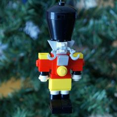 An Omaha family makes these ornaments, and donates of the proceeds to charities supporting children in shelters. Lego Christmas Ornaments, Indoor Christmas Decorations, Nutcracker Christmas, Christmas 2019, Diy Christmas, Minecraft Lego, Lego Winter Village, Lego Village, Lego Advent Calendar