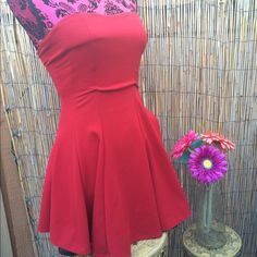 Romantic Sweetheart Vibrant red dress, with a sweetheart neckline and cinched bust. And strapless. Has a nice flow and a-line style. Very form fitting and flattering. Perfect for a romantic date!! Never worn, in excellent condition. ANGL Dresses Strapless