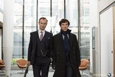 SHERLOCK (BBC) ~ S4 photo: Mycroft (Mark Gatiss) and Sherlock (Benedict Cumberbatch) Holmes.