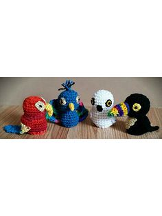 "4 adorable birds made using #4 worsted-weight yarn. An owl, a parrot, a peacock and a toucan are included in this pattern. Each measure approximately 4"" tall. Designs use 6mm safety eyes and are stuffed with fiberfill."