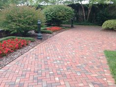 Landscaping with brick will give your yard a park like atmosphere. Pine Hall Brick pavers can be used for driveways, walkways, courtyard, and patios. Shown are Old Towne pavers which have a colorful confetti-like look.
