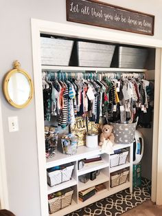 Nursery closet organization. This bookshelf and the bins are AMAZING for orginizing a little ones closet. Nursery Spare room combo designed by Jennifer Boyd Designs.