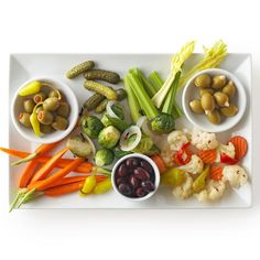 Relish tray inspiration. Ideas: Variety of olives, celery sticks, carrots, pickles/cornichon, pickled vegetable mixture, pepperoncini, etc.